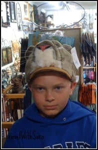 Garrett in hat shop in Colorado