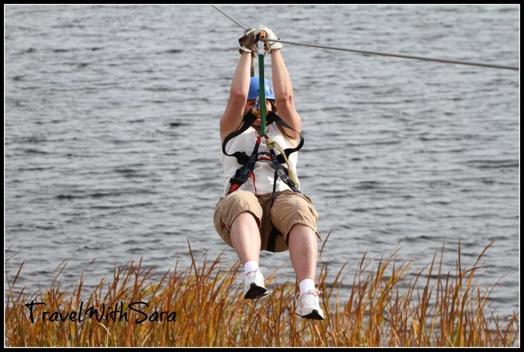 Sara ziplining over water