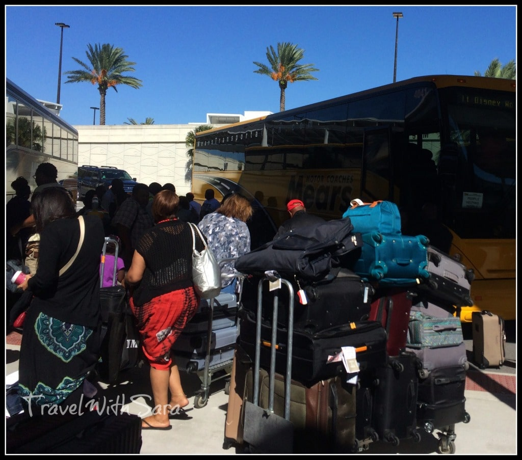Luggage and people boarding shuttle