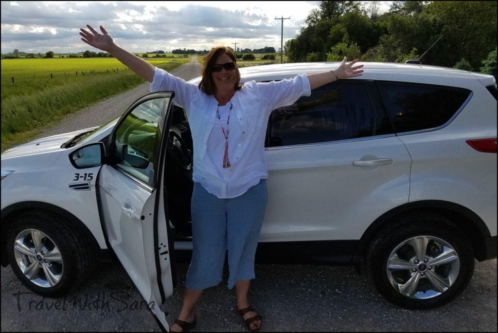 Sara with rental car