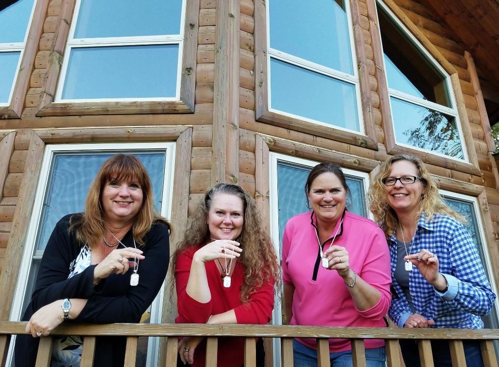 Bloggers outside cabin