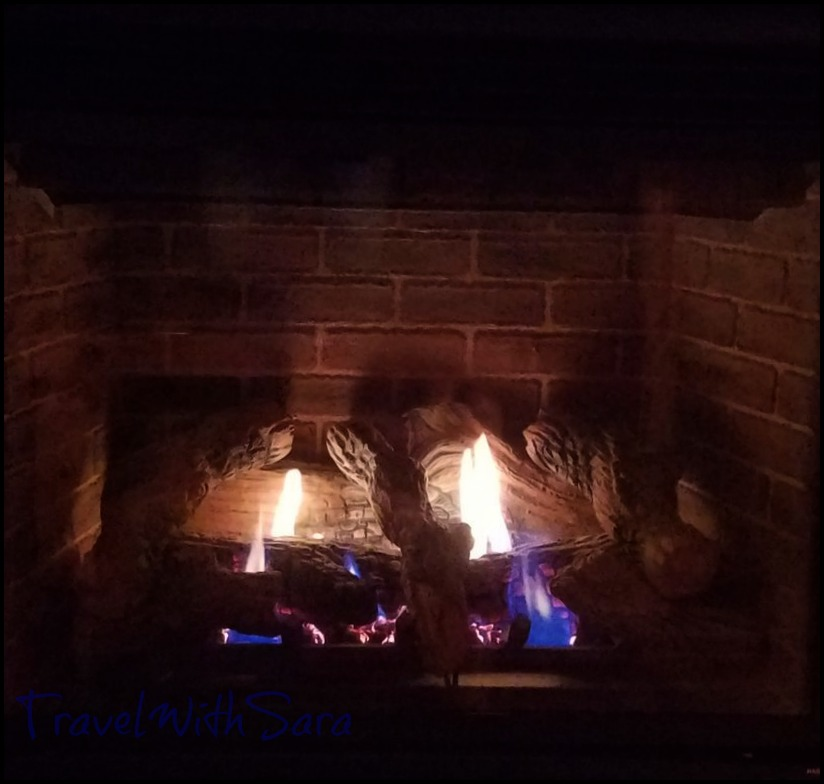 A fireplace in the luxury cabins in the Midwest at Red Cedar Lodge