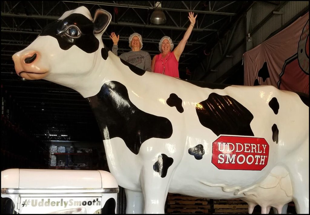 Laura and Sara with cow