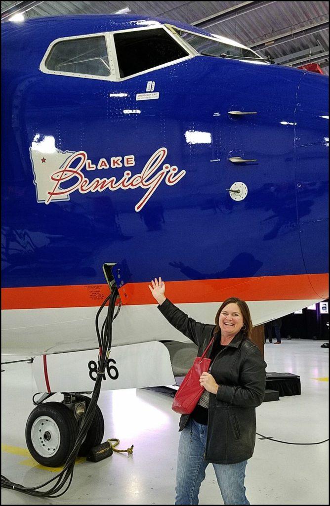 Sara with Sun Country plane