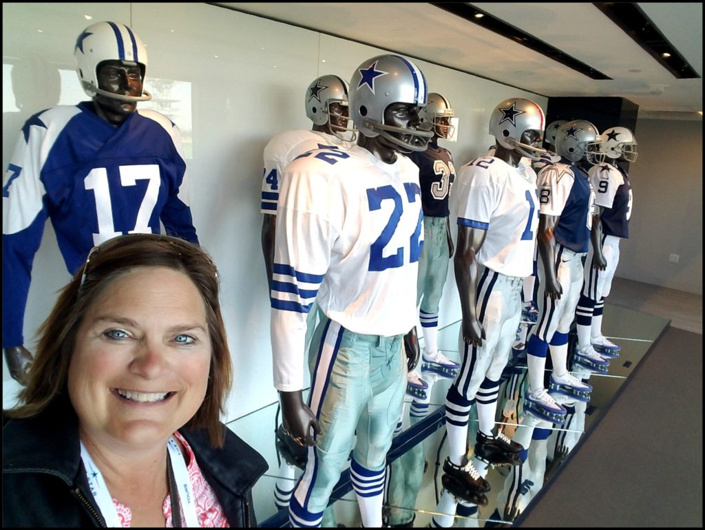 Sara with Dallas Cowboy uniforms