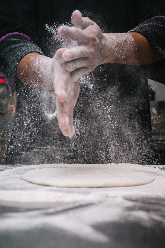 Hands Mixing Flour