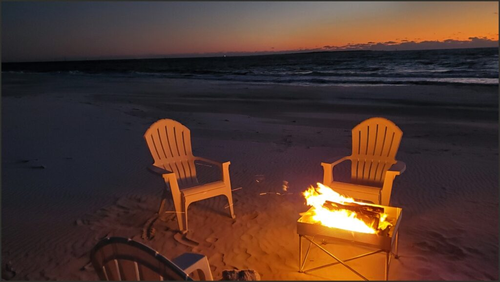 best small towns to visit bonfire on beach